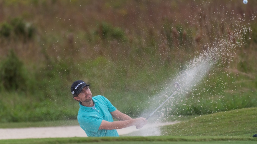 PORT ST. LUCIE, FL - OCTOBER 3: Zach Johnson hits out of a bunker on the fourth hole during the first round for the 43rd National Car Rental Assistant PGA Professional Championship held at the PGA Golf Club on November 14, 2019 in Port St. Lucie, Florida. (Photo by Hailey Garrett/PGA of America)